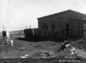 "25 B. Hughey 9-1950 Cruise - Filching ""props"" from diserted ranch house - SMI 1.jpg"