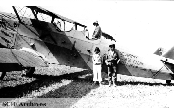 File:SRI Mrs Hayden Hunt in plane. Frances Smith & EK Smith standing ca.1920s.jpg